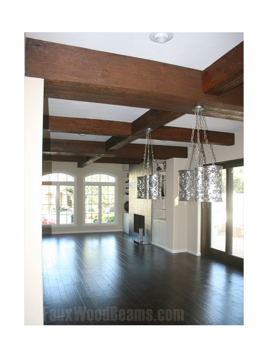 Sandblasted Faux Beams - Faux sandblasted beams can help to give an open space more visual appeal and serve as a means for adding lighting elements.