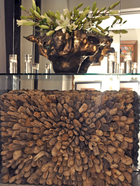 Showroom Pieces - Driftwood Coffee Table that may be used under a sleek glass console