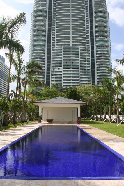 Infinity pool with solid dark blue glass tile traditional