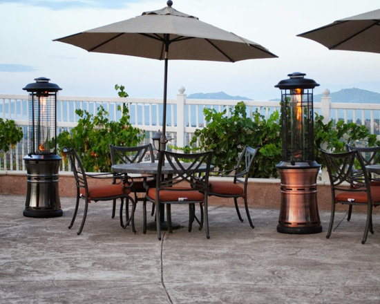 Lava Heat Ember Propane Patio Heater - Available in gun metal or brushed copper and natural gas or propane options, the Lava Heat Ember Propane Patio Heater will effortlessly provide additional ambiance to any commercial or residential outdoor area. -Mantels Direct