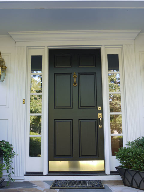Simpson 6 panel wood door with bronze kick plate black for Black wooden front door