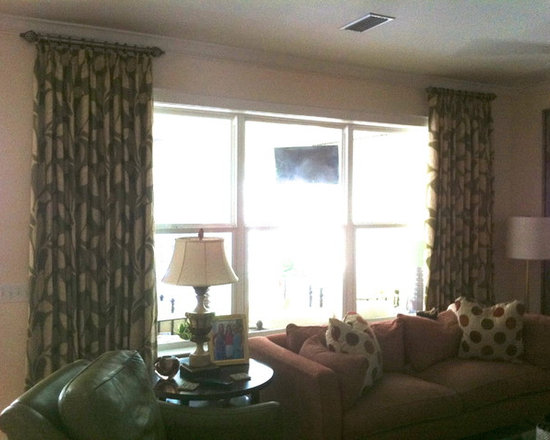 Family Room - Stationary side panels on short poles.  Design by Michael Meloy.  Installation by Curtain Pros.
