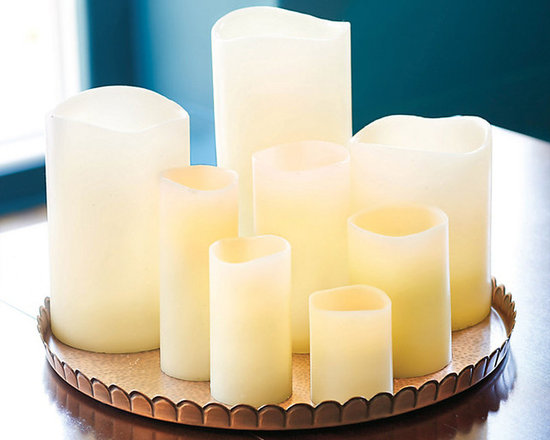 Ballard Designs - Set of 3 Remote Control Flameless Wax Candles - Can be operated by timer to run in 4, 6 or 8 hour intervals at the same time daily. Also can be controlled by Remote (sold separately). 3diameter candle have a 300-hour battery life; 4and 6diameter candles have a 1000-hour battery life. Requires 4 AA batteries (not included). Can also be operated manually. With our Remote Controlled Flameless Candle, you can enjoy the romance of flickering candlelight without the worry of an open flame or the hands-on hassle. This flameless LED candle is coated in ivory paraffin wax for a remarkably realistic look. Remote Controlled Candle features: .  . .  . . Unscented.