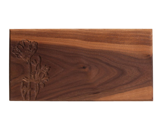 DMWR - Poppy Cutting Board - This beautiful slab of solid walnut, hand carved with a California poppy, is pretty enough for hanging, and it's got the keyhole on the back to prove it. But, it'll look twice as nice with some freshly sliced fruit or cheeses on it — chop and serve them right on the board.