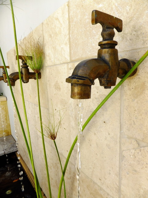 Travertine waterwall with Brass taps