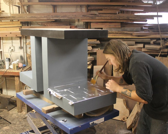 Works in Progress - Will is completing the delicate and painstaking work of silver leafing a Double L Monolith Base.