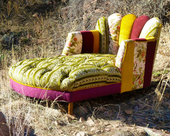 Vintage Furniture Redesigned - We shouldn't have favorites, but what can we say? I am sure you will love it as much as we do! This recycled chaise has been completely deconstructed and rebuilt to include a wonderful fanned channel back in a vibrant array of hand picked and patch-worked one-of-a-kind vintage fabrics. The seat interior has been tufted in a lush emerald and ivory luxurious vintage fabric. The welt cord running throughout the piece is in a lush pile vintage gold fabric. The burgundies, golds and emeralds are so fabulous together creating a true work of art that will wow all of your guests.