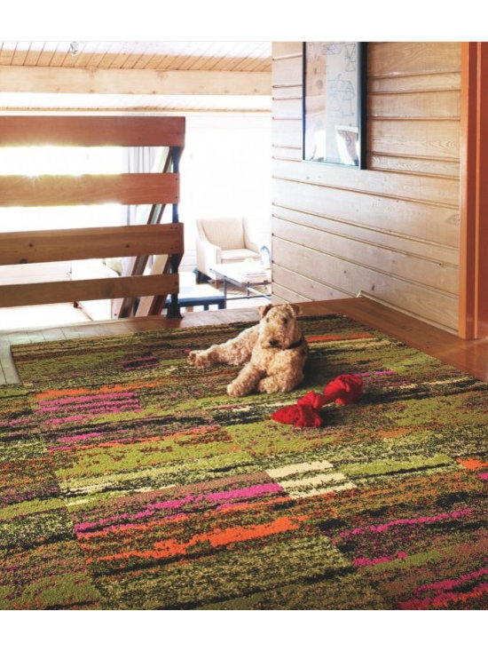 Cambium Carpet Tile in Geranium - This almost static-like pattern reminds me of gazing up close at a vibrant impressionist painting. The colors are super-saturated — perfect for carpet tiles that are easy to change out at your whim.