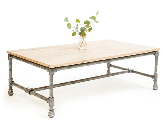 5 Horizons - Griffin Coffee Table - Crafted from solid oak timbers and steel reinforced accents, the Griffin collection is sure to add a utilitarian edge to any setting.  Whether in an urban loft in the city or in a cozy cottage in the country, this collection makes a statement with its mix of materials and modern yet rustic feel.