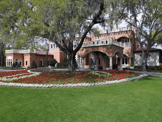 Front yard landscaping at the Tourmaline by Luxury Home Builders in Tampa - Mediterranean ...