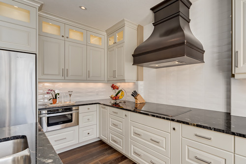white cabinets and Cosmic Black granite countertops