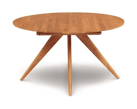 "Copeland Furniture - Catalina Round Extension Table, 48 Inches | Copeland Furniture - Hand-crafted in Vermont by Copeland Furniture.The Catalina Round Extension Table, 48 Inches is the ideal solution for small spaces. Constructed from solid cherry or walnut hardwood, the tapered legs of this dining table radiate out from a central point for a dynamic look. Easily open the table to access the self-storing butterfly leaf and expand the table to an oval shape to comfortably accommodate more people. The Catalina Round Extension Table, 48 Inches offers a small compact size that is perfect for small dining rooms or breakfast nooks.  Copeland Furniture uses sustainably harvested hardwoods from the American Northern Forest. All lumber used by Copeland Furniture comes from within 500 miles of their factory in Vermont, thus reducing fossil fuel consumption and carbon dioxide emissions from transportation. The environmental values of preservation and stewardship are reflected in every piece of furniture produced by Copeland Furniture. Product Features:  Self equalizing, ball bearing extension glides Single 24"" wide self-storing butterfly leaf Single handed operation Expands up to 72"" wide  Finished with a low sheen top coat Made to order in the U.S.A."