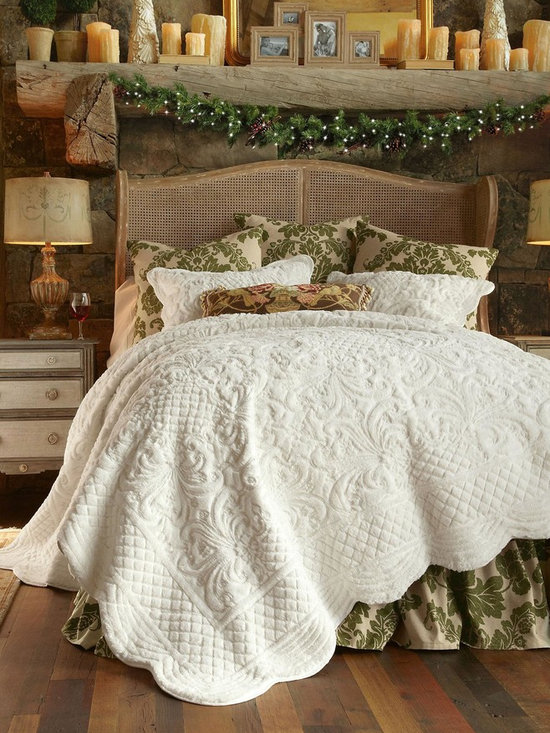 Chalet Quilt - Transform your bedroom into a luxurious retreat with our Chalet quilt and sham (sold separately). We've re-cast traditional flourishes, florals, scrolls and lattice motifs in irresistibly soft and fluffy faux fur. A delight to the senses in snowy ivory, mushroom, or spa blue, finished with gently scalloped edges and backed is silky cotton sateen. You may never want to get out of bed... and who could blame you?