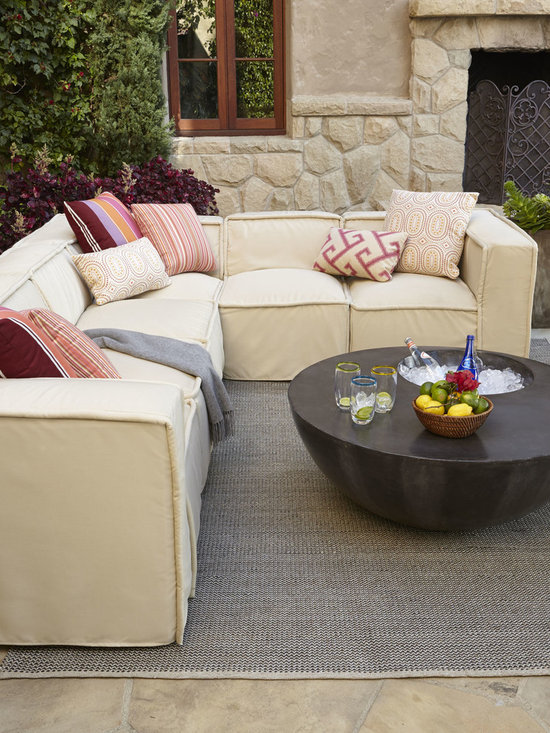 'Kendall' Outdoor Sectional - Just because you're outdoors doesn't mean you can't dine in style. An outdoor sectional brings guests together in comfort and style in your outdoor living space.