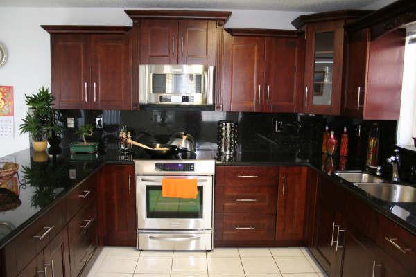 Cherry kitchen cabinetry orlando by golden hammer for Cheap kitchen cabinets in orlando fl
