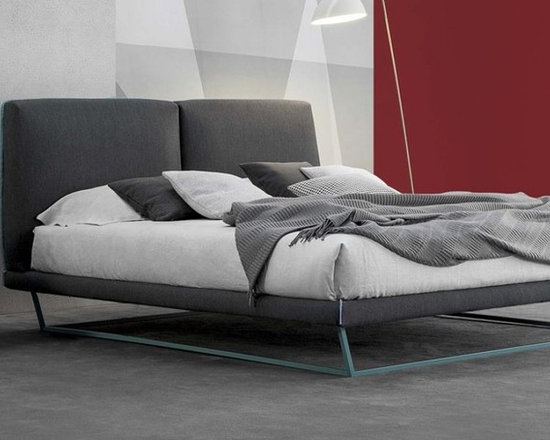 Amlet Bed - The Amlet has the slim painted metal base supports the padded frame, giving it this particular appeal. The design is strikingly simple yet with original details. The headboard, with a wooden frame and polyurethane padding, is upholstered with fabric or leather.