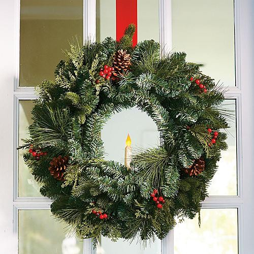 classic window christmas wreath with taper candle