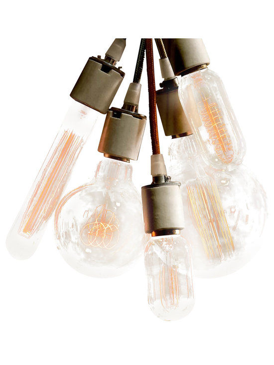 Globe and Tube Filament Bulbs - Made with the same technique and materials used in early Edison bulbs, these generate a warm flow at a low light level.  Each style has a distinct filament pattern when illuminated. Our European-standard 60 watt bulbs are appropriate for U.S. fixtures and burn at a gentle 15 watts due to the lower U.S. voltage. Filament Bulbs burn less energy and will last longer than standard 60 watt bulbs.
