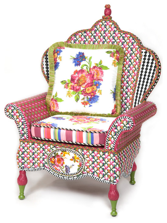 Flower Market Outdoor Wing Chair | MacKenzie-Childs - Our Flower Market Outdoor Furniture Collection blooms where planted. We've captured the colors of summer in Aurora—pink, fuchsia, green, orange, red and blue—with this collection. Fancy, fun, and just a touch eccentric, with inset Flower Market enamelware panels and black and white accents, front and back. Sturdy, easy care, and made to withstand the elements. Hand-woven resin wicker, powder-coated metal accents, solid iron frame. Includes one Flower Market Outdoor Throw Pillow.
