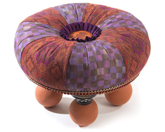 Bittersweet Tuffet | MacKenzie-Childs - Part footstool, part seating, and all functional fun. Our Bittersweet Tuffet is wrapped in alternating panels of rich Bittersweet plum-and-chocolate checks, and a robust tapestry of warm autumn tones. Each is accented with passementerie trim around the edges, and an embossed round leather thistle button with a ribbon ruffle at the center. Rests on majolica feet, handmade and decorated by our artisans in Aurora with Courtly Check and gold-lustre accents.