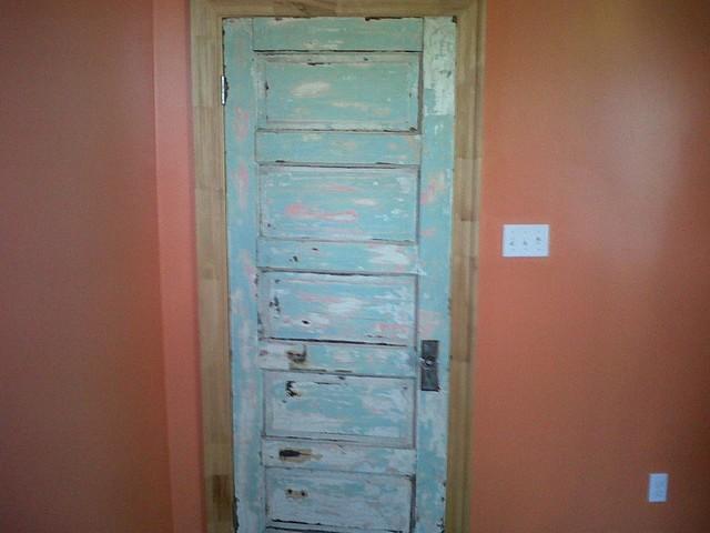 Collins Builders Salvaged Heart Pine and Antique Oak Flooring eclectic-interior-doors