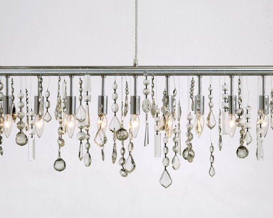 Crystal Linear Suspension by Nuevo Living - Crystal linear suspension features 38 crystal strands and a chrome finish. Hard-wire application, canopy included. Nine 25 watt, 120 volt, B10 candelabra base incandescent lamps not included. General light distribution. Includes 60 inch cord. 3W x 12H x 47.25L.
