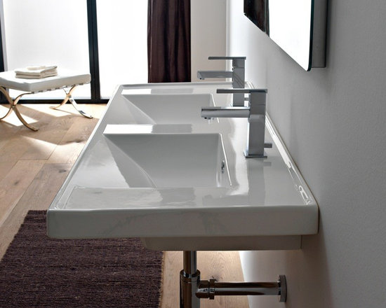 "Beautiful Rectangular Double Ceramic Sink - This beautiful rectangular sink is made of high-quality ceramic. Sink is made and designed in Italy. Wall mounted double bathroom sink features overflows and a choice of two hole (as shown), no hole or six hole options. Sink dimensions: 48"" x 18.5"" x 2"""