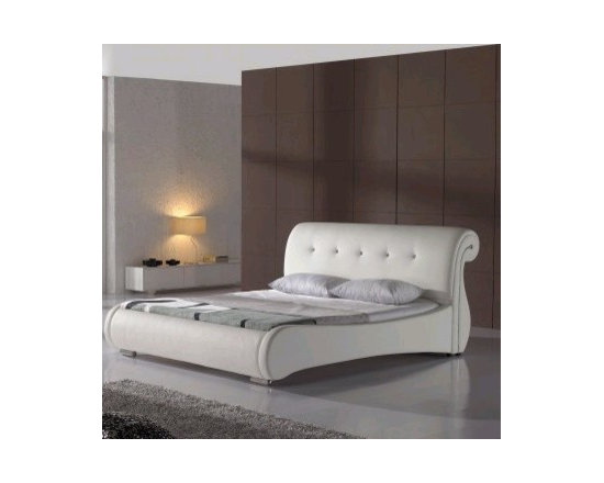 Ulrich Bed Frame - The Ulrich Modern Leather Bed Frame incorporates a modern take on a classic sleigh style headboard design. With rich luxurious hand tufted genuine leather upholstery, this is a piece you are sure to enjoy for years to come.