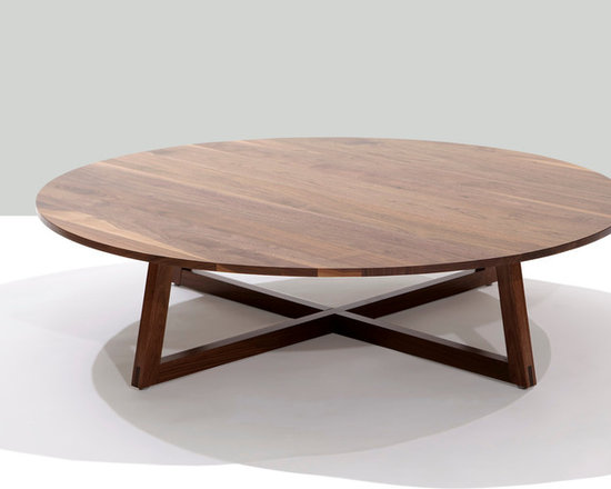 Finn Large Round Coffee Table - Finn is a solid wood table with angled frame-style legs. The intersection at the base anchors the design to the floor and contrasts with the visual lightness of the tabletop. A great design to pair with clean-lined contemporary upholstery and modern classic styles.