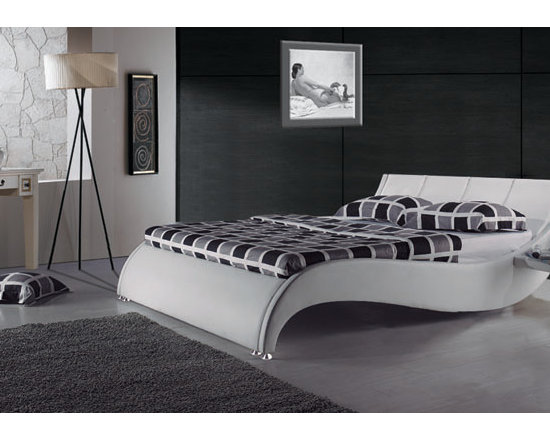 Yorkshire Modern Leather Bed Frame with Built in Side Tables - Ultra modern meets ultra functional in the Yorkshire Modern Leather Bed Frame. Featuring smooth contemporary design cues, built in side tables, and upholstered in genuine leather.