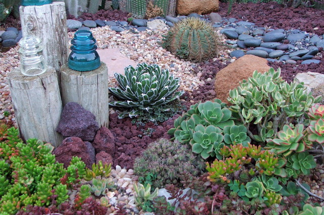 Landcaping with succulents, rocks, gravel and logs