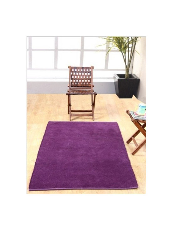 Chenille Plain Rug Purple - This delightful hand woven rug is available in many beautiful plain colours in five sizes. These solid or plain coloured rugs can be very well coordinated with Homescapes chenille cotton stripes rugs as well. It can be washed in your domestic machine and is ideal for children