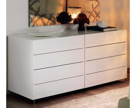 Cattelan Italia - Cattelan Italia | Dyno Double Dresser - Made in Italy by Cattelan Italia.Elegance in simplicity and superior construction make up the modest yet modern architecture of the Dyno Double Dresser. The solid premium wood frame of this low two-sided dresser cradles eight spacious drawers, enabling easy storage and organization of multiple types of garments.  A facade of soft leather adds an element of luxury to the furniture's look. Wide stainless steel feet set at a slanted position make for a stylish support mechanism. Personalize the look of your bedroom by selecting from a range of wood lacquers as well as leather colors and textures, making decorating effortless.