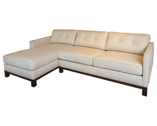 Cosmo Sectional - The straight, clean lines of the arms and base combined with classic button tufting on the cushions make the Cosmo sectional a chic twist on tradition.