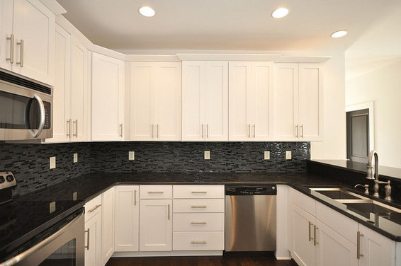 Black pearl granite countertops with glass mosaic ... on Backsplash For Black Granite  id=92227