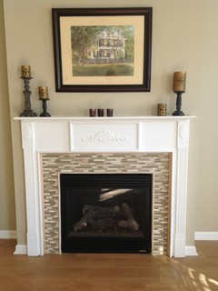 Wood-look tile on the floor and glass mosaic on fireplace ...