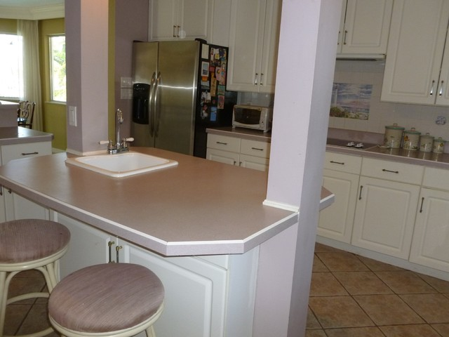 kitchen cabinets materials former kitchen note the mauve and grey paint countertops 3092