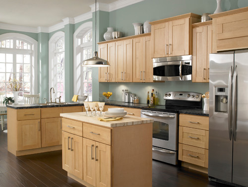 Love this wall color with the Maple cabinets and dark wood ...