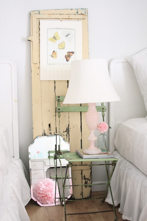 Use a rustic chair as a beautiful nightstand as seen on Dreamy Whites. See more repurposing projects on Design Dazzle!