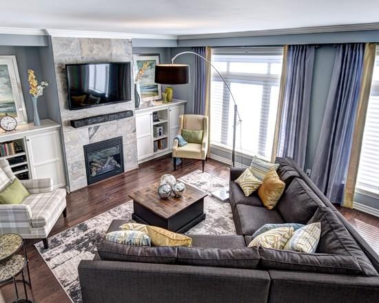 Dream living room design blue gold tones stone fireplace grey sofa