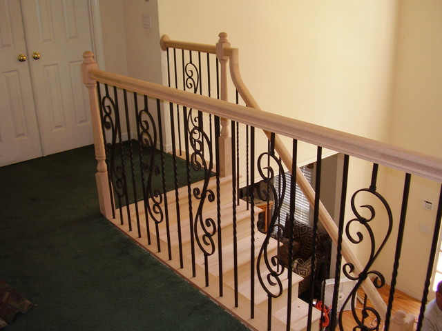 fireplace decor ideas wood railing and metal balusters traditional staircase 31309