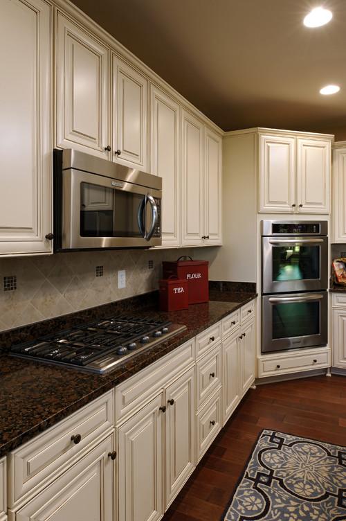 Baltic Brown Granite White Cabinets Backsplash Ideas on Black Granite Countertops With Brown Cabinets  id=74636