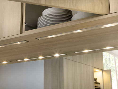 easy install under cabinet lighting hardwired accentuate your countertops and brighten up dark spaces by installing undercabinet lighting with these detailed instructions you can easily install how to install undercabinet kitchen lighting
